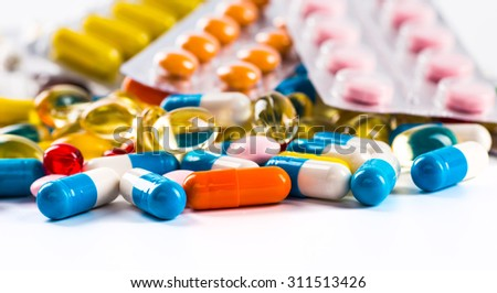 Pills in the flask, vials and the tubes with medications on white background - stock photo