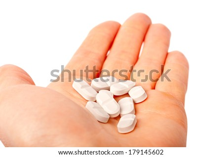 pills in the hands isolated on white medicine concept