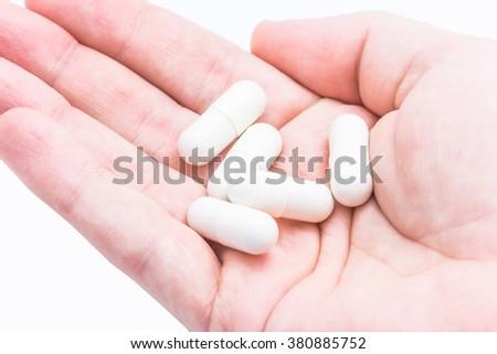 Pills on hands. Medicine background. - stock photo