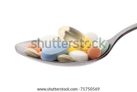 Pills on spoon with clipping path