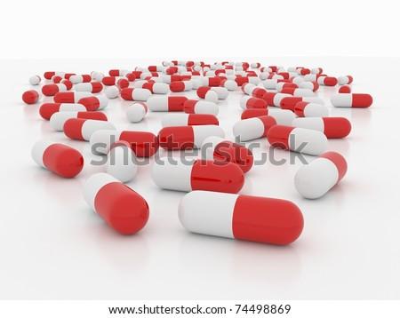 Pills on white - stock photo