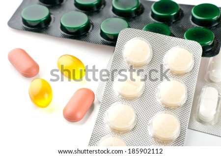 Pills over white background