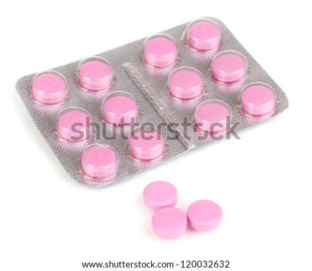 Pills packed in blister isolated on white - stock photo