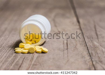 Pills pouring out of the bottle, drug  - stock photo