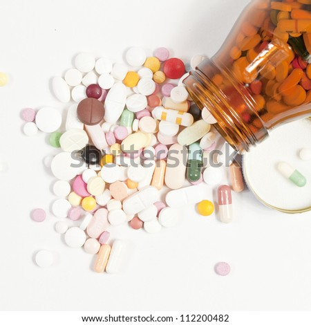 Pills pouring out of the brown bottle.