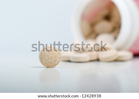 Pills spilling out from a prescription bottle,Prescription Drugs - stock photo