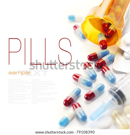 Pills spilling out of pill bottle and Syringe isolated on white (with sample text) - stock photo