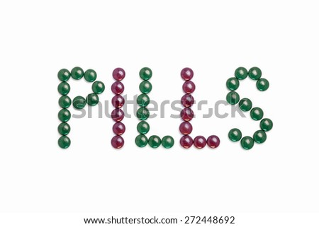 Pills written with green and purple pills  - white background - stock photo