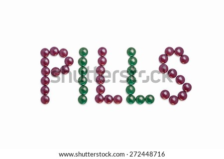 Pills written with purple and green pills  - white background - stock photo