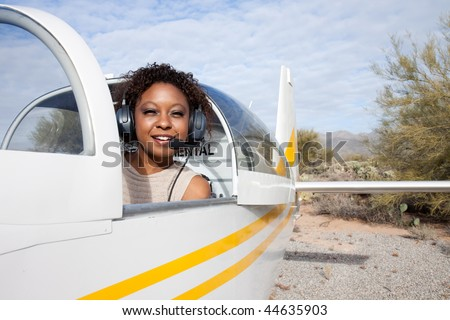 Pilot and plane on the runway - stock photo
