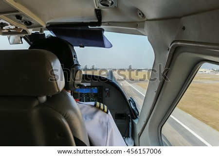 Pilot in cockpit of airplane