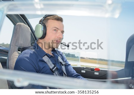 pilot in the cockpit - stock photo
