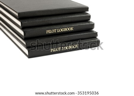 Pilot logbook stacked up with only two marked with PILOT LOGBOOK