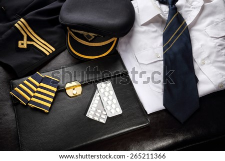Pilot on psychotropic medication pills - stock photo