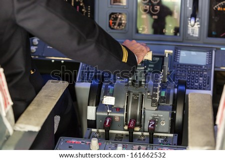 Pilot Operating the Throttle for Taking Off - stock photo