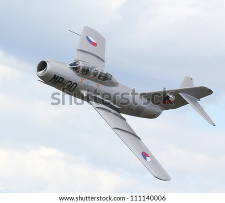 PILSEN, CZECH REPUBLIC - AUGUST 26: Famous Soviet fighter jet Mig-15UTI with Czech Air Force marking. Only one in Europe. Pilsen Aeronautical Days on August 26, 2012 in Pilsen, Czech Republic. - stock photo