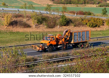 PILSEN, CZECH REPUBLIC - OCTOBER 1, 2015: Maintenance car moving on the D5 highway. The D5 is important transport connection between West Bohemia and Bavaria in Germany. - stock photo
