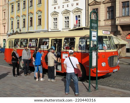 PILSEN, CZECH REPUBLIC - SEPTEMBER 28, 2014: Old historical bus on Pilsen square. Pilsen city celebrate title of the European Capital of Culture 2015. - stock photo