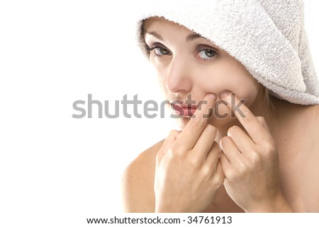 Pimple , spot on beauty woman face with a white towel - stock photo