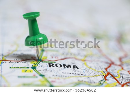 Pin indicates the destination on the road map - Roma (Italy) - stock photo