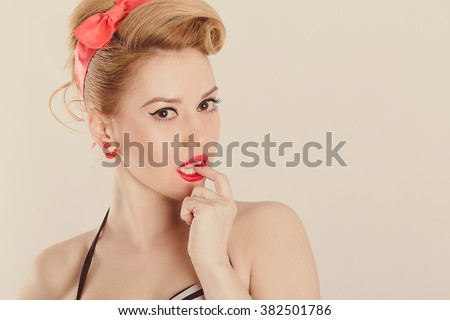 Pin-Up cute girl in classic fashion polka retro style posing in front of camera