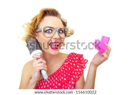 Pin-Up funny girl with hairstyle holding comb and curlers, isolated on white - stock photo
