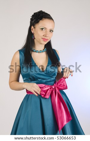 Pin-up girl.  Beautiful young girl in blue dress - stock photo