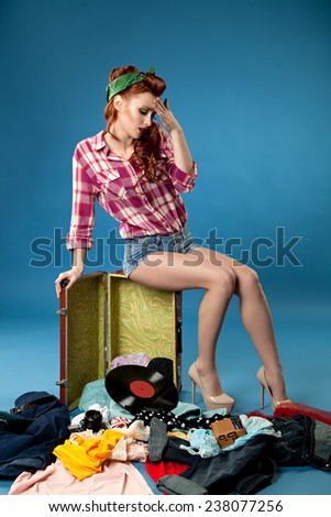 pin-up girl. beautiful young woman isolated on white in studio in old fashion clothes representing pinup and retro style - stock photo