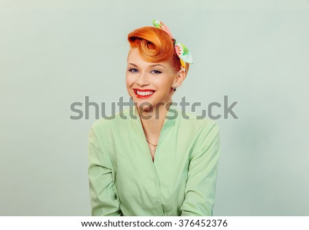 Pin up girl. Close up portrait headshot of red head young woman pretty smiling girl  in green button shirt, formal wear looking at you, camera with retro vintage 50's hairstyle. Positive human emotion - stock photo