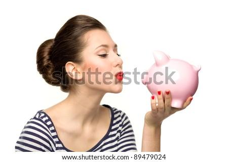 Pin-up girl kissing piggy-bank - stock photo