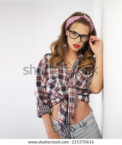 Pin-up girl wearing a headband and glasses - stock photo