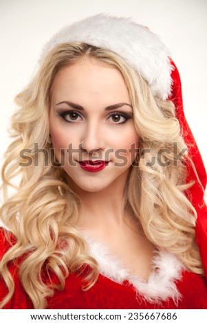 pin-up portrait of a passionate sexual Santa in the studio on a white background