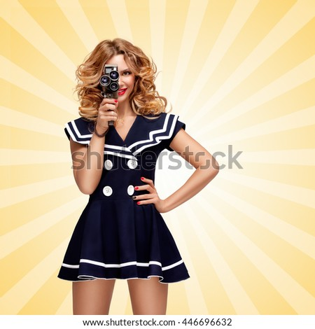 Pin-up sailor girl with a vintage cinema 8 mm camera shooting a movie on cartoon style background. - stock photo