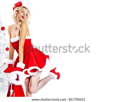 Pin-up sexy girl wearing santa claus clothes - stock photo