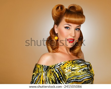 Pin-up Style. beautiful young woman in studio in old fashion clothes representing pinup and retro style. Styled Fashion Model in Retro Dress - Glamour. Heritage. - stock photo