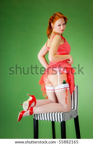 Pin-up style girl shows her beautiful ass - stock photo