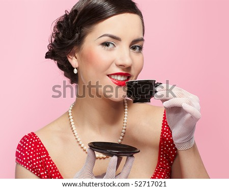 pin-up style portrait of beautiful brunette girl with tea cup - stock photo