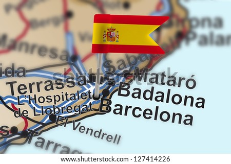 pin with flag of Spain in Barcelona with selective focus - stock photo