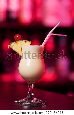 Pina Colada cocktail shot on a bar counter in a nightclub - stock photo