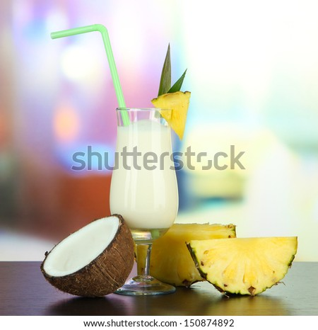 Pina colada drink in cocktail glasses, on bright background - stock photo