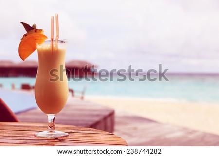 pina colada on tropical beach vacation - stock photo
