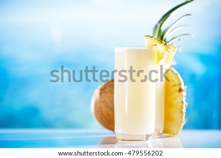 pinacolada pina colada cocktail on beach with seascape background