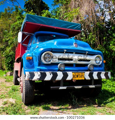 PINAR DEL RIO,CUBA-APRIL 7:Old Ford truck in a rural road April 7,2012 in Pinar del Rio.Before a new law issued on October 2011,cubans could only trade vehicles that were on the road before 1959 - stock photo