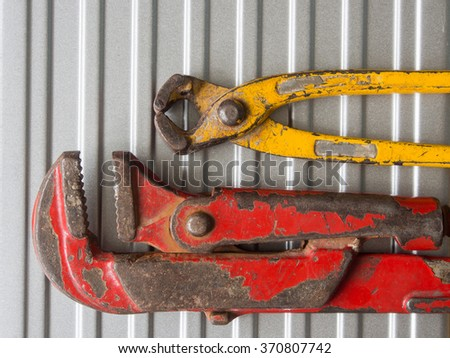 Pincers and Pipe Wrench - stock photo