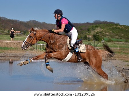 PINCINA, SLOVAKIA APRIL 28: Unidentified rider competes at the International Eventing Championship Spring Military on April 28, 2012 in Pincina, Slovakia