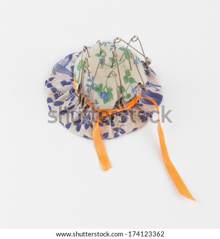 pincushion in the form of caps - stock photo
