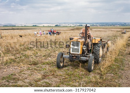 Pinczow, Poland - September 14, 2015: .old tractor on harvest field  in Poland