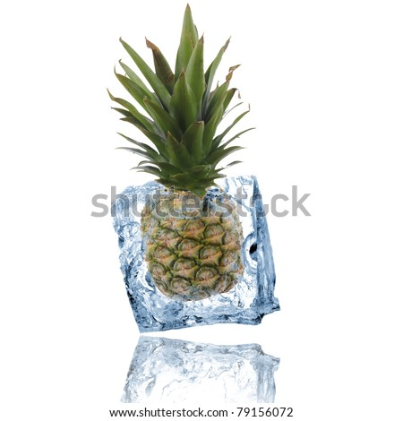 Pine apple frozen in ice cube - stock photo