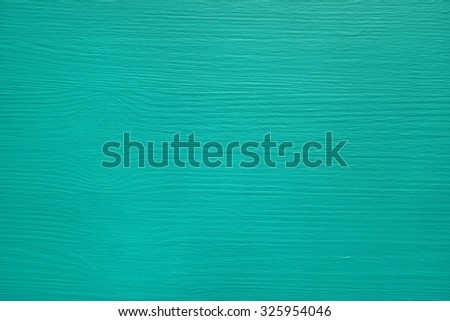 Pine board painted teal, wood grain texture showing through - stock photo