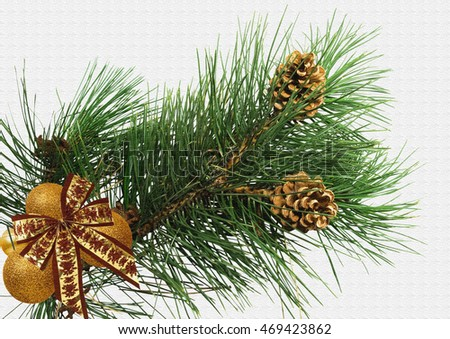 Pine Branch with Christmas Balls on a textured background